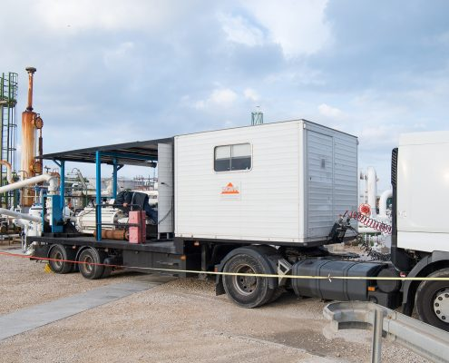Calibration and maintenance of measuring instruments on a chemical site with trailer-mounted compact prover